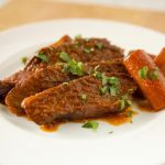 Slow Cooked Brisket with Wine, Rosemary and Thyme